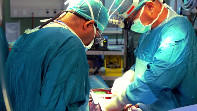 surgeons operate on heart - concentration stock videos & royalty-free footage