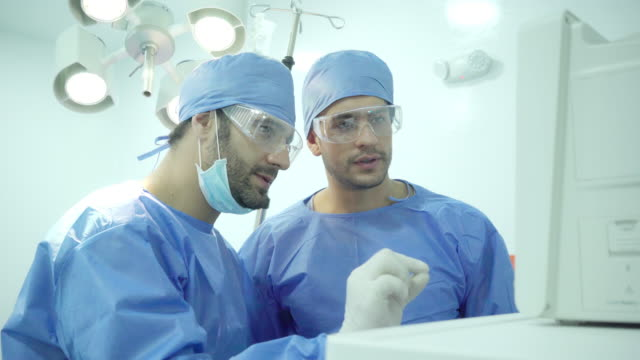 surgeons plan what they will do to their patient - surgeon stock videos & royalty-free footage