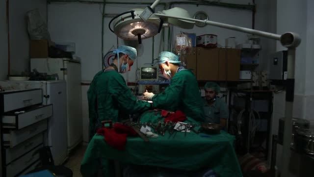 Surgical consultations via Facebook reused sutures and gloves and half doses of expired drugs doctors in a besieged opposition enclave near Syria's...