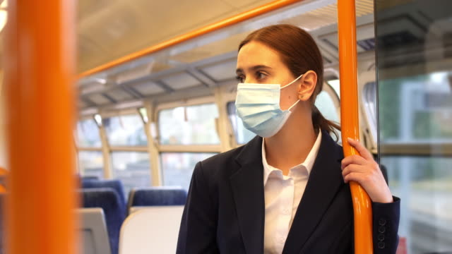 surgical mask travel travel. young woman commuter. - mobile phone stock videos & royalty-free footage