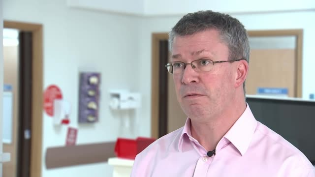 surgical robots helping revolutionise the treatment of bowel disease and cancer england buckinghamshire milton keynes int joe harrison interview sot... - belly stock videos & royalty-free footage