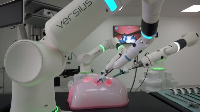 surgical robots helping revolutionise the treatment of bowel disease and cancer england cambridgeshire cmr surgical int dr mark slack demonstrating... - robot stock videos & royalty-free footage