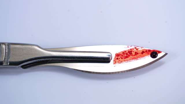 surgical stainless steel metal scalpel with blood - scalpel stock videos & royalty-free footage