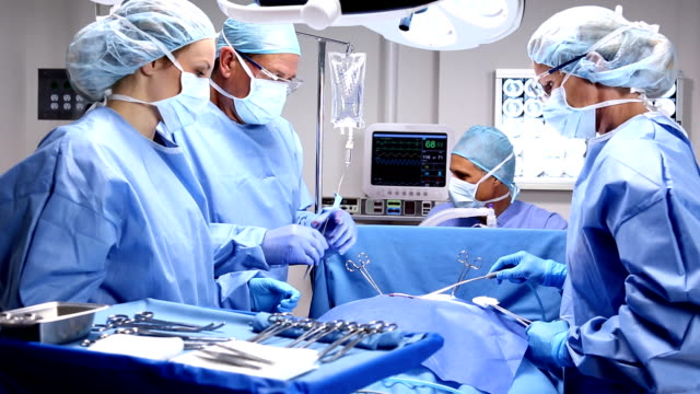 surgical team - operating stock videos & royalty-free footage
