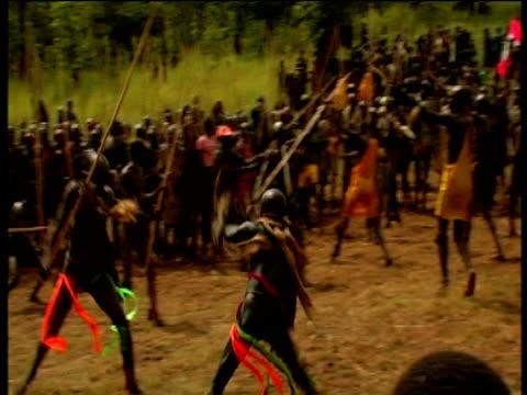 vídeos de stock e filmes b-roll de suri males battle during donga stick fighting contest suri territory ethiopia - corno de áfrica