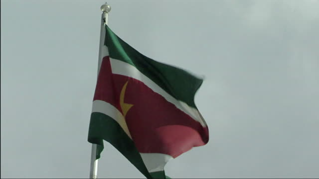 cu suriname flag flapping in wind / nu aurora, suriname - nu stock videos & royalty-free footage