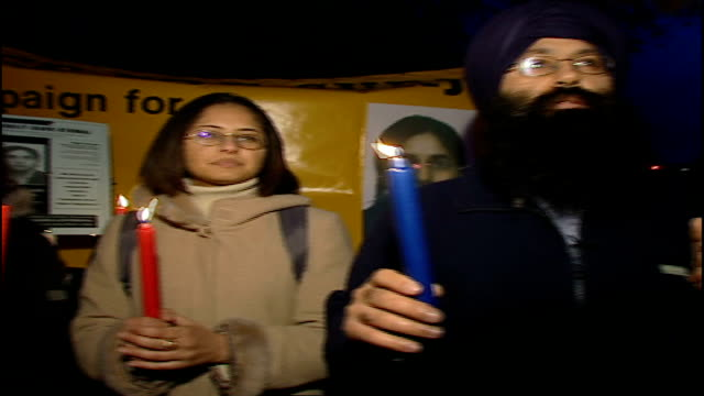 motherinlaw found guilty date jagdeesh singh and others holding 'justice for surjit' placards during candlelit vigil - mother in law stock videos & royalty-free footage