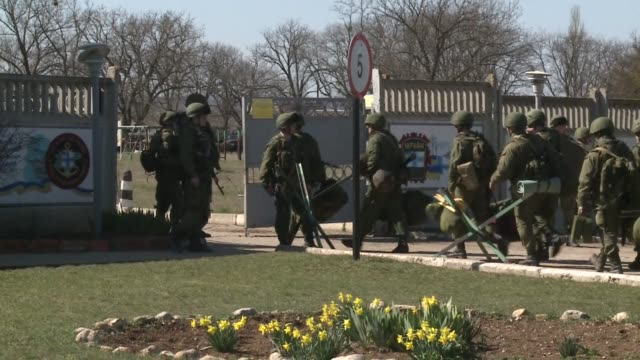 surly and dejected many ukrainian soldiers at perevalne base in crimea deserted their posts friday crossing groups of buoyant russian soldiers moving... - sevastopol crimea stock videos and b-roll footage