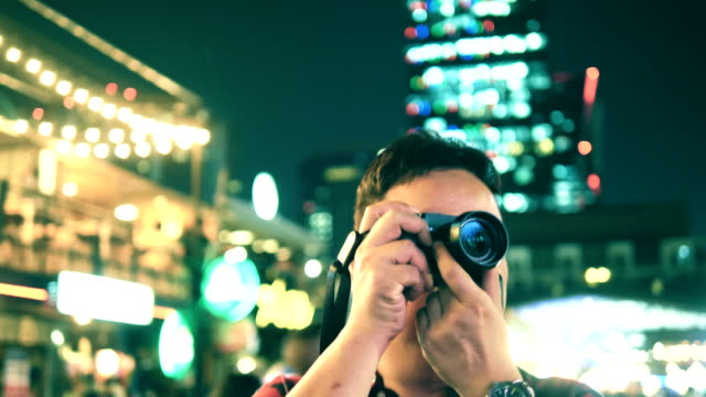 Surprise : Asian Tourist Man Taking Picture At NightLife