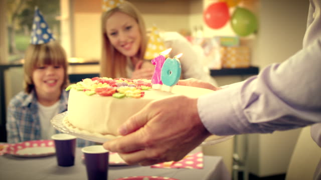slo mo surprise cake for girls tenth birthday - carrying stock videos & royalty-free footage