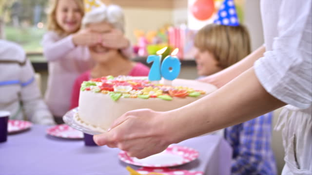 slo mo surprise cake for grandma - carrying stock videos & royalty-free footage