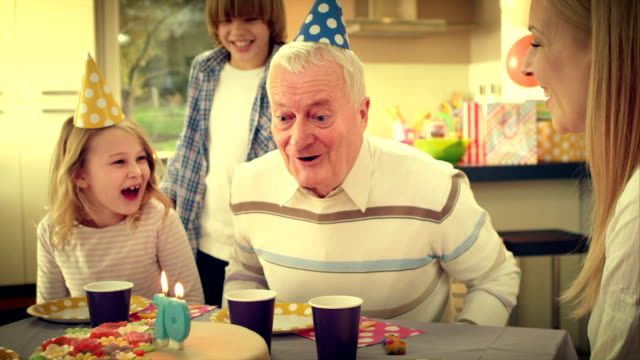slo mo surprise cake for grandpa - mid adult men stock videos & royalty-free footage