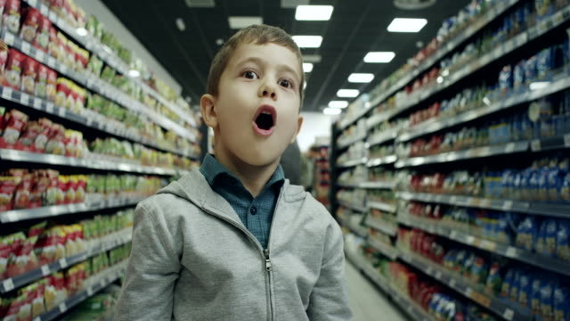 surprised boy in supermarket - excitement stock videos & royalty-free footage