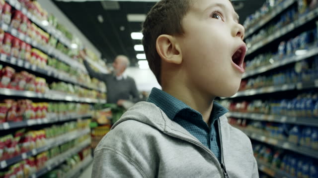 surprised boy in supermarket - surprise stock videos and b-roll footage