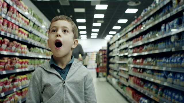 surprised boy in supermarket - surprise stock videos & royalty-free footage
