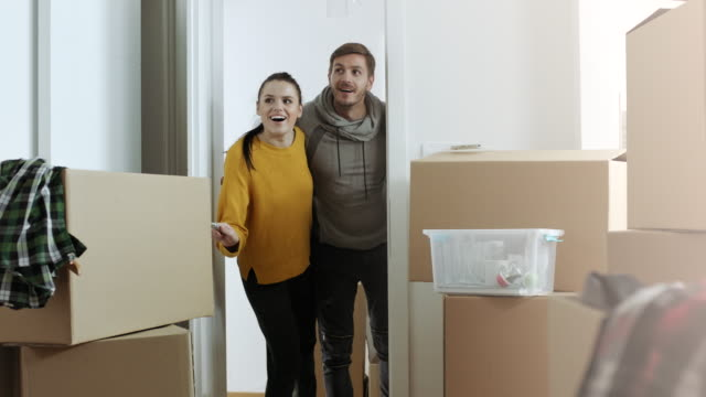 Surprised couple with their new apartment
