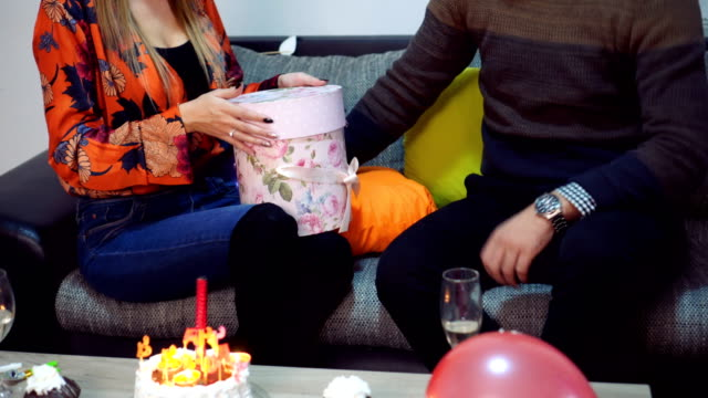 surprised woman receives a gift - birthday cake stock videos and b-roll footage