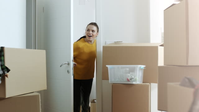 surprised woman with her new apartment - carton stock videos & royalty-free footage