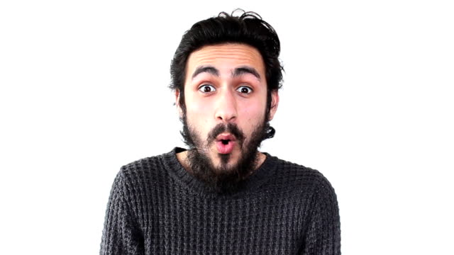 surprised young man looking at camera in excitement - white background stock videos & royalty-free footage