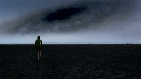 surreal desert. woman admiring black hole - vortex stock videos & royalty-free footage
