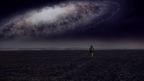 surreal desert. woman admiring galaxy - surrealism stock videos & royalty-free footage