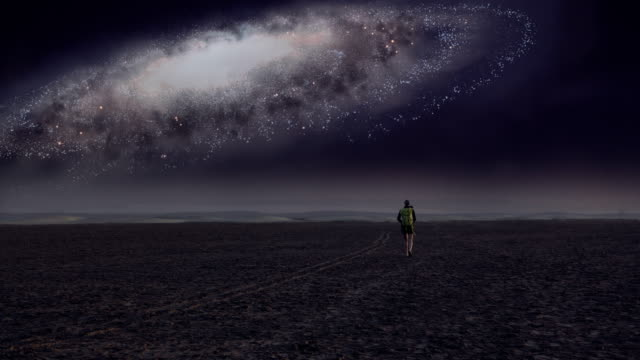surreal desert. woman admiring galaxy - surrealism stock videos & royalty-free footage