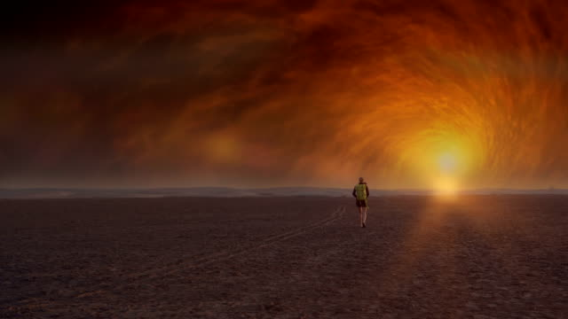 surreal desert. woman admiring space radiation - surrealism stock videos & royalty-free footage