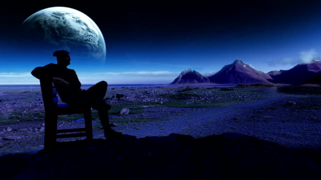 surreal landscape. huge planet in background. man sitting on the rock - atmosphere filter stock videos and b-roll footage
