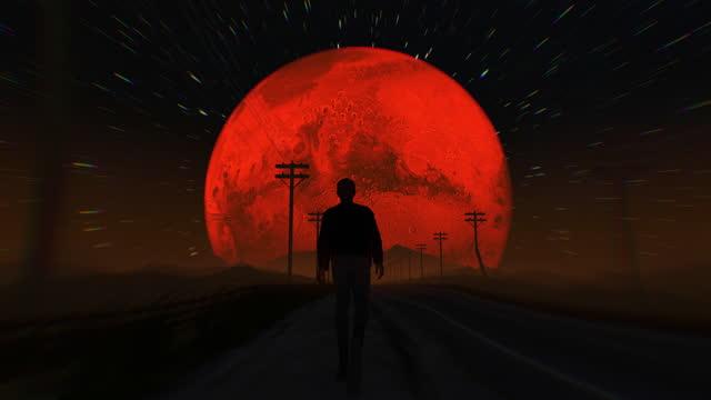surreal, mountain road. man walking towards galaxy - light natural phenomenon stock videos & royalty-free footage