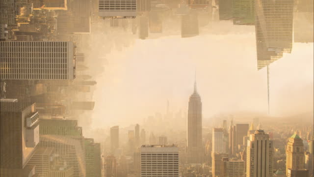 surreal picture of manhattan skyline bending the cityscape with day and night composition. - upside down stock videos & royalty-free footage