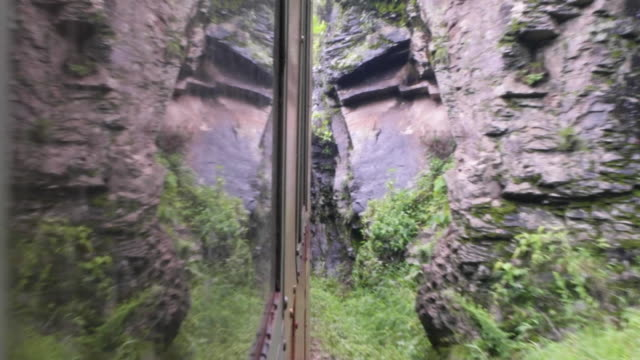 surreal reflection on the window of a train of the surrounding landscape, captured from the pov of a passenger looking out of a window - british rail stock videos & royalty-free footage