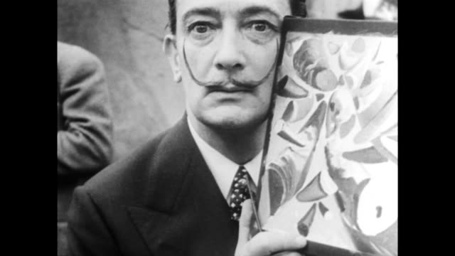 surrealist painter salvador dali setting up easel to paint a picture of a rhinoceros at the vincennes zoo / cameramen filming the event / dali... - artist stock videos & royalty-free footage