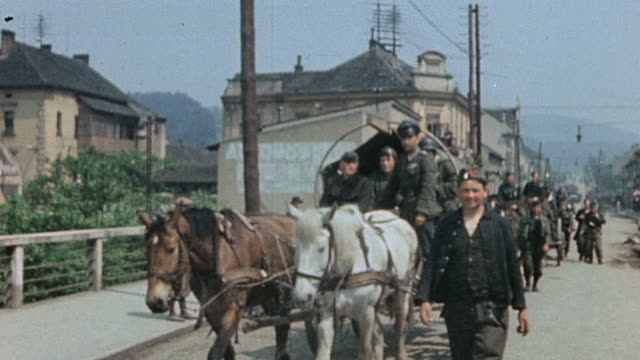 surrendering german army and polish soldiers marching riding pushing bicycles driving horsedrawn wagons in trucks and a jalopy / pilsen czech republic - ve day stock-videos und b-roll-filmmaterial