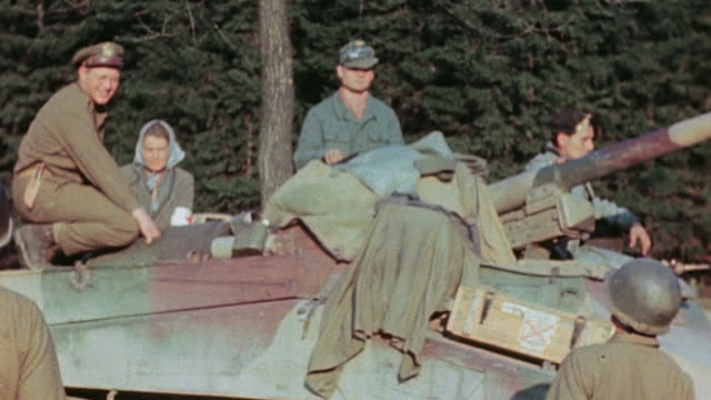 vídeos de stock, filmes e b-roll de surrendering german army soldiers atop camouflaged sdkfz 234 speaking with gis on the ground and german army vehicles lined up to surrender /... - wehrmacht