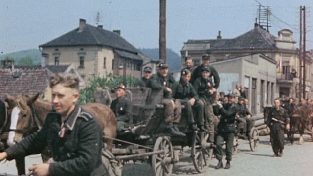 surrendering german army soldiers marching driving horsedrawn wagons in trucks / pilsen czech republic - wehrmacht stock videos & royalty-free footage