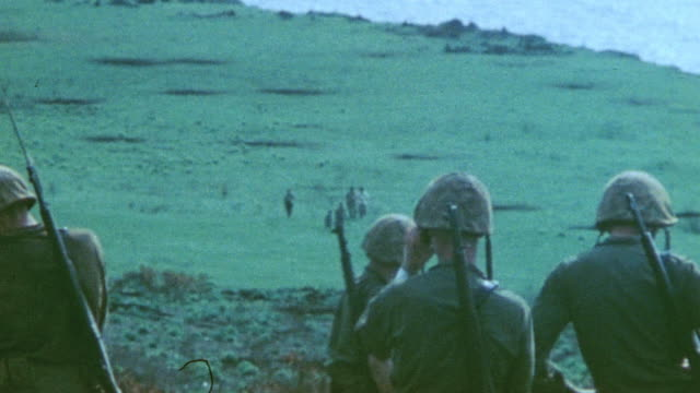 surrendering soldiers walking toward marines and standing atop a hill waving handkerchiefs during world war ii - 日本の軍事力点の映像素材/bロール