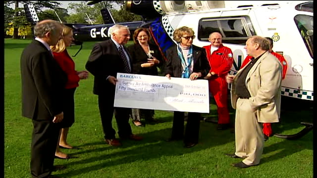 campaigners celebrate cheque from council; penelope keith receiving cheque for fifty thousand pounds from an unidentified local surrey county... - penelope keith stock-videos und b-roll-filmmaterial