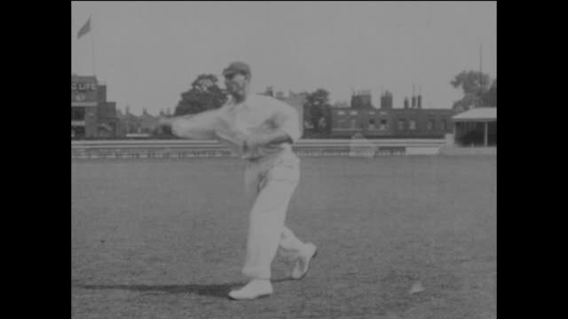 surrey and england cricketer jack hobbs demonstrating his fielding skills, and throwing the ball to wicketkeeper bert strudwick at the kennington... - oval kennington stock videos & royalty-free footage