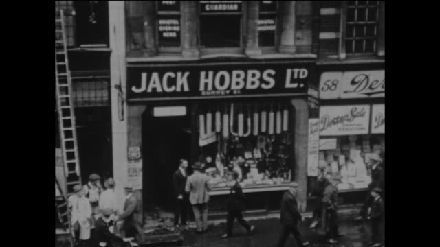 surrey and england cricketer jack hobbs outside his new sports shop in fleet street, london, circa may 1925. - fleet street stock videos & royalty-free footage