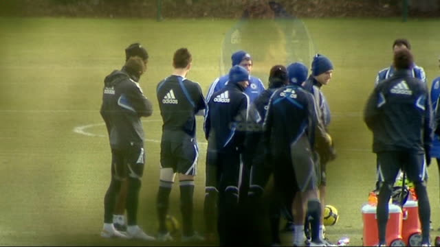 surrey cobham ext long shots showing john terry warming up in training session chelsea players huddled around carlo ancelotti back view terry... - cobham surrey stock videos and b-roll footage