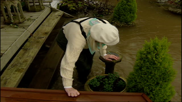 surrey county council flood protection plans tx surrey thames ditton people along in flood waters caused by burst water main - surrey england stock videos & royalty-free footage