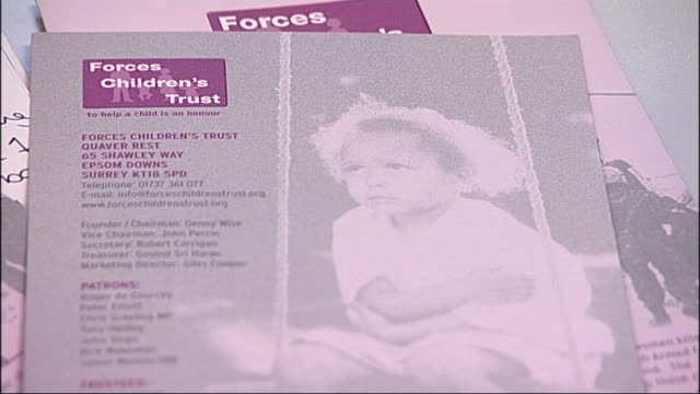 epsom: int close shot of literature in connection with 'forces children's trust' charity denny wise interview sot - children are the forgotten... - literature stock videos & royalty-free footage