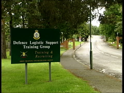 sign at entrance to deepcut army barracks fence pull focus buildings - barracks stock videos & royalty-free footage