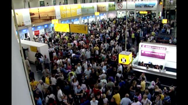 gatwick airport **frances tuke interview partially overlaid sot** passengers in crowded terminal - crowded airport stock videos & royalty-free footage