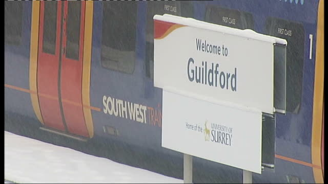 surrey guildford 'guildford' train station sign on platform - guildford stock videos and b-roll footage