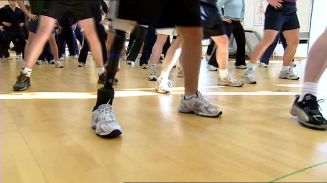 headley court rehabilitation centre soldier with prosthetic leg exercising with others in gym at mod rehabilitation centre - prosthetic equipment stock videos & royalty-free footage