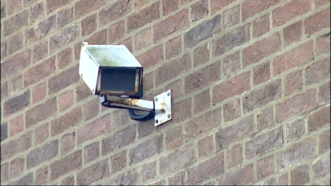 """vídeos de stock e filmes b-roll de surrey police and crime commissioner suggests people may extra for more policing; england: surrey: ext """"making surrey safer"""" sign at closed police... - making money"""