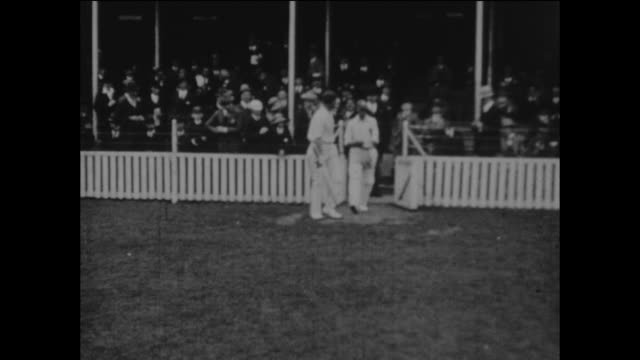 surrey's opening batsmen jack hobbs and andrew sandham walking out to bat during the county championship cricket match between surrey and middlesex... - oval kennington stock videos & royalty-free footage