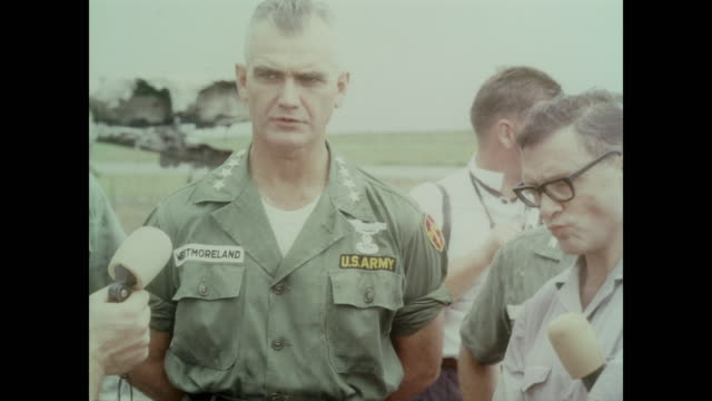 surrounded by damaged planes and eager reporters general william westmoreland conducts press interview in the wake of an attack on bien hoa air base - note pad stock videos & royalty-free footage