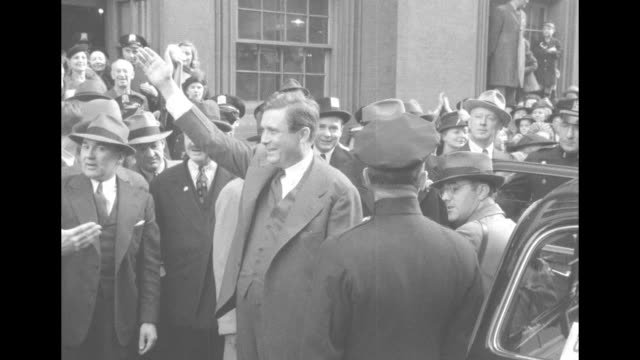MS surrounded by huge crowd Wendell Willkie wife Edith exit polling place at 85th Street and Madison Avenue NYC / MS he stands at automobile waving...